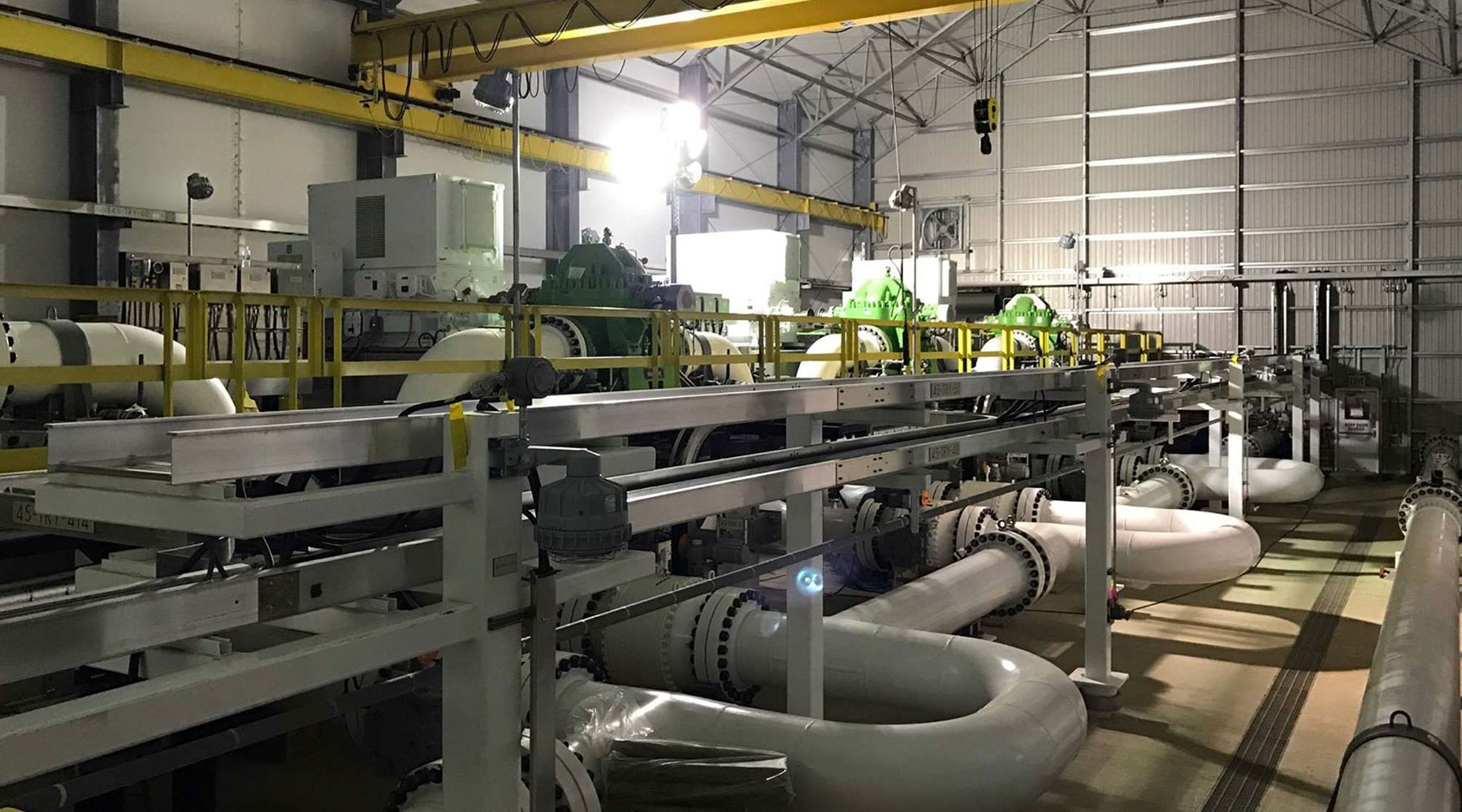 Picture of pipes, equipment and machinery inside of a workshop