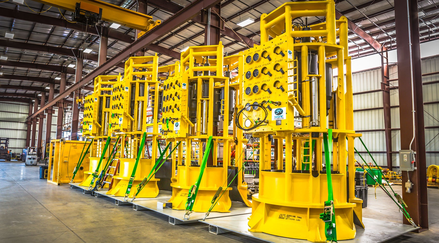 Image of four large pieces of subsea equipment