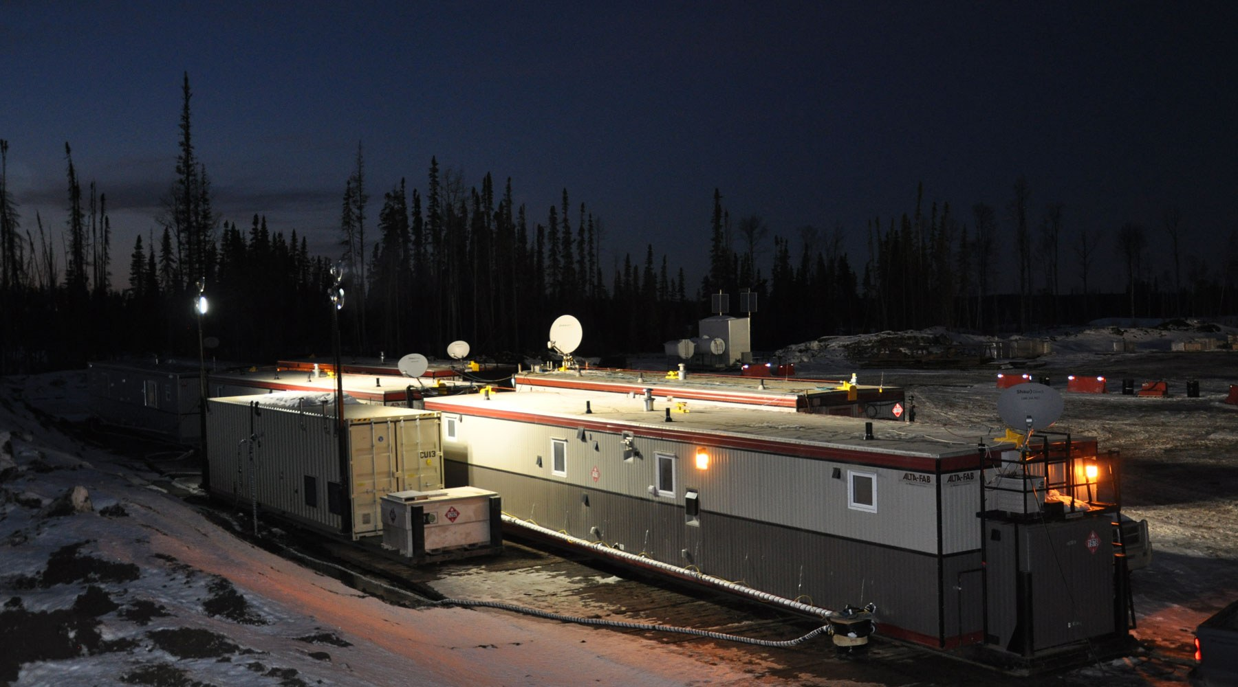 A work camp photographed at night