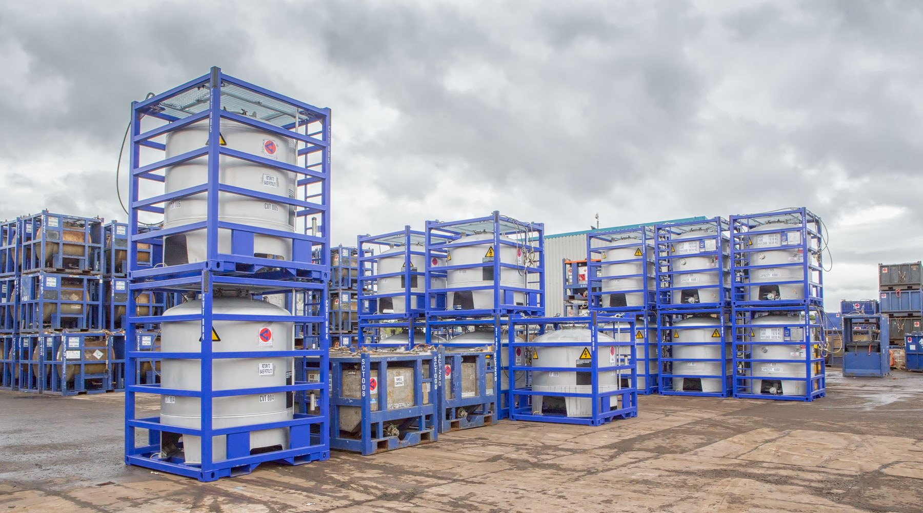 Containers encased in shipping baskets